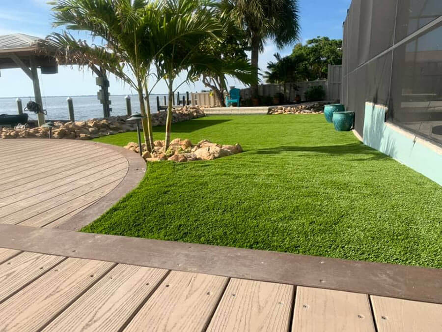 deck next to synthetic turf and landscaping