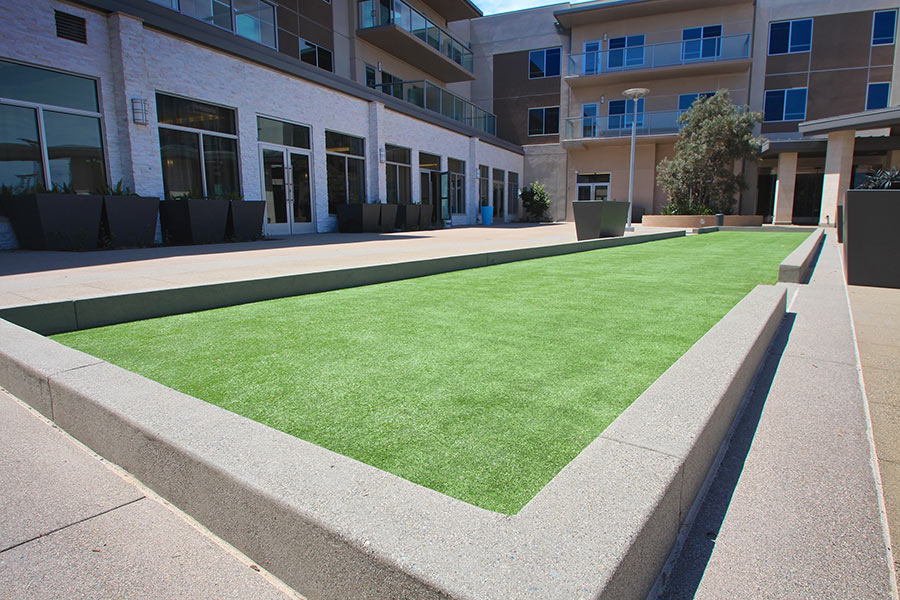 synthetic turf outside of an apartment complex