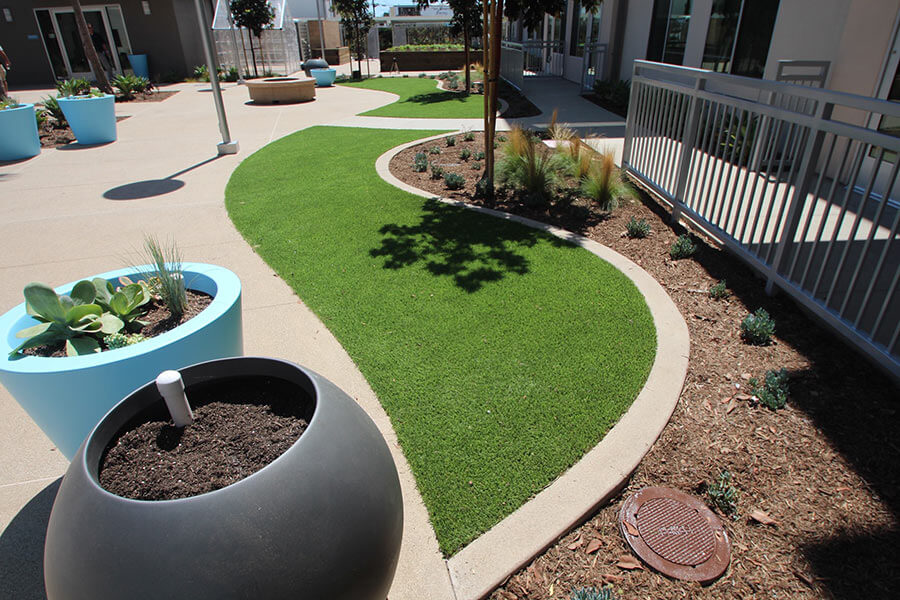 manicured backyard patio with landscaping