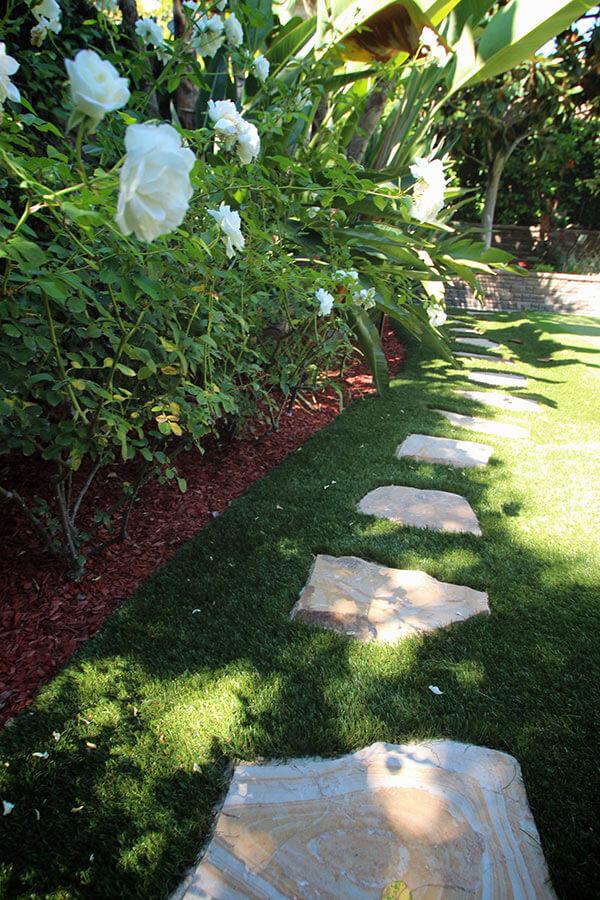 backyard with paving stone walkway